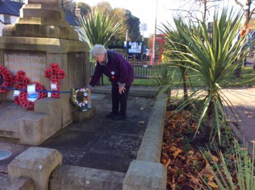 Wreath being laid on behalf of Disley Quaker Meeting